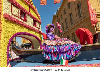 METZ, FRANCE - AUG 26, 2018: people enjoy the performance at the The Mirabelle Plum Festival in Metz, France. people in venetian costumes perform a parade watched by thousands of locals and tourists.