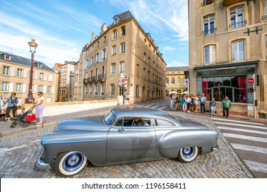 METZ, FRANCE - August 26, 2017: Street view with tourists and old retro car in Metz city, Lorraine region in France