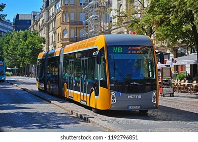 METZ, FRANCE - JULY 8, 2018 - Van Hool Mettis bi-articulated hybrid bus, operated by Le Met' company, on a dedicated and segregated busway