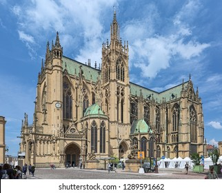 METZ, FRANCE - MAY 15, 2018: Cathedral of Saint Stephen of Metz. View from Place d'Armes on the south-east facade. The present Gothic building was built in 1220-1550 and consecrated April 11, 1552.