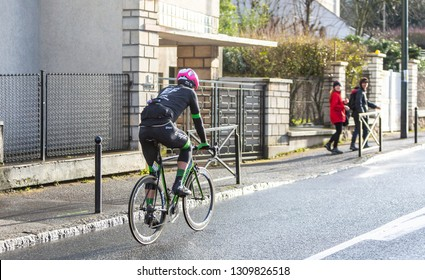 Meudon, France - March 4, 2018: Rear view of the New Zealand cyclist Tom Scully of  Team EF Education First-Drapac Cannondale riding during Paris-Nice 2018.