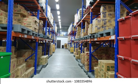 Meung, Rayong / Thailand - May 3,2018 : Many boxes on blue rack in storehouse.