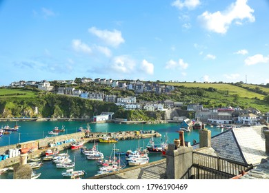 MEVAGISS, UNITED KINGDOM - Jul 05, 2020: Mevagissey, Cornwall, England / UK - July 5, 2020: View of Mevagissey Harbour on a sunny Summer day with colourful fishing boat. Cornwall, UK