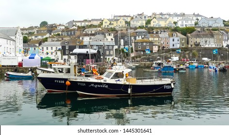 Mevagissey, Cornwall. England- June 26, 2019: The charter mackerel boat Aquila FY 324 moored in the harbour during the annual Fish Festival. With background of the village to the skyline.