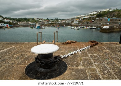 Mevagissey Cornwall harbor close up of chain and mooring post.