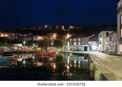 Mevagissey Cornwall - September 16 2019: Mevagissey harbour at night time the village is within the Cornish Area of Outstanding Natural Beauty and is a popular destination for tourists