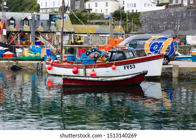 Mevagissey Cornwall - September 16 2019: Mevagissey harbour with boats at anchor the village is within the Cornish Area of Outstanding Natural Beauty and is a popular destination for tourists