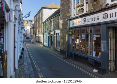 Mevagissey Cornwall - September 18 2019: Fore Street in the coastal town of Mevagissey the village is within the Cornish Area of Outstanding Natural Beauty and is a popular destination for tourists