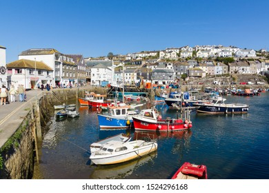 Mevagissey Cornwall - September 18 2019: Mevagissey harbour with boats at anchor the village is within the Cornish Area of Outstanding Natural Beauty and is a popular destination for tourists