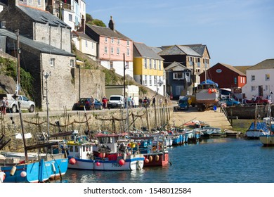 Mevagissey Cornwall - September 18 2019: Mevagissey harbour with boats at anchor and picturesque and colorful fishermens cottages