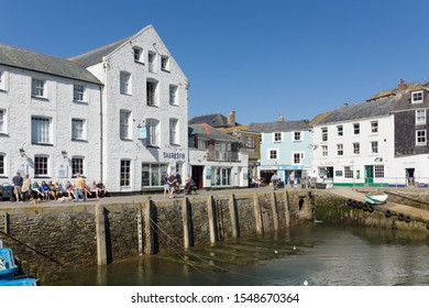 Mevagissey Cornwall - September 18 2019: Mevagissey harbour with tourists on the seafront in the Cornish Area of Outstanding Natural Beauty and is a popular destination for tourists