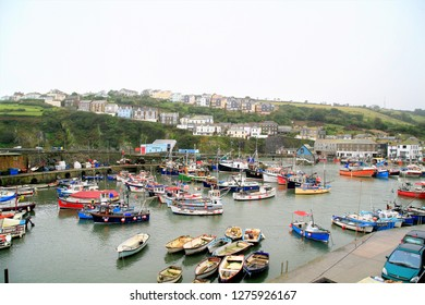 Mevagissey, Cornwall, UK. Ocober 05, 2015. The inner harbor filled with boats and yachts on a overcast day in October at Mevagissey in Cornwall, UK