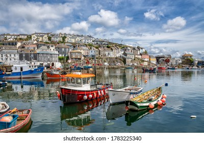 Mevagissey, England - July 2020: Fishing boats in Mevagissey Harbour, Cornwall, England, United Kingdom