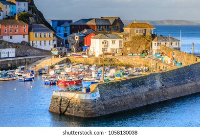 Mevagissey Harbour in early spring evening light.  Mevagissey is a traditional Cornish fishing village. Mevagissey, UK - March 27th 2018.
