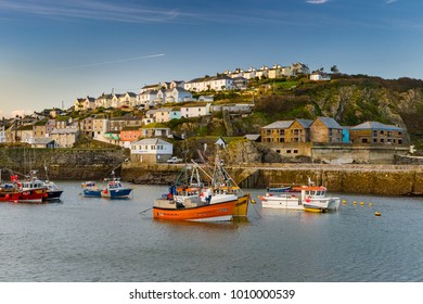 Mevagissey harbour finally quietens down after a busy day of fishing.