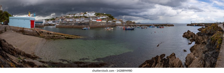 Mevagissey UK June 15th 2009 : Panoramic view of the harbour at Mevagissey in Cornwall on a dramatic stormy summer afternoon