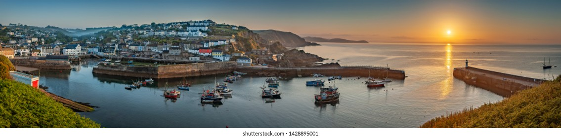 Mevagissey UK June 15th 2009 : Panoramic view of the harbour at Mevagissey in Cornwall at sunrise