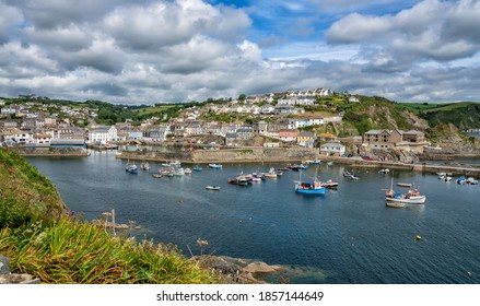 Mevagissey, United Kingdom - July 2020: Fishing boats in Mevagissey Harbour, Cornwall, England, United Kingdom
