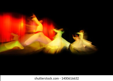 mevlevi dervishes dancing in front of black and red backgound