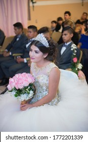 Mexicali, Baja California/ Mexico> Nov-17-2018: A Latin Mexican teenager, attending mass for her quinceañera or 15th birthday as part of Mexican traditional celebration.
