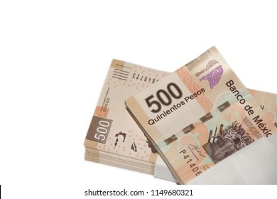 Mexican 500 peso bills viewed from above on white background