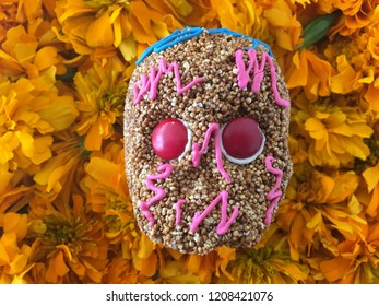 Mexican Amaranthus Skulls over cempasuchitl flowers for the day of the dead