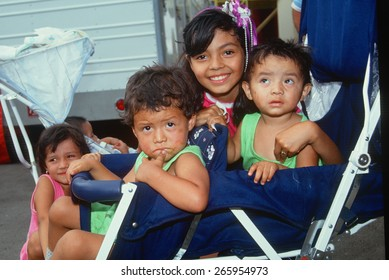 Mexican American children in a stroller, Los Angeles, CA