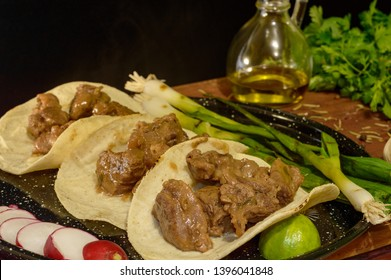 Mexican arrachera tacos with sides and herbs, low key with copy space