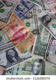 mexican banknotes and american dollars bills,  background and texture