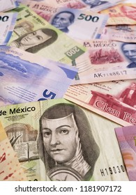 mexican banknotes of various denominations unorganized, background and texture