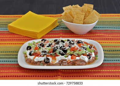 Mexican Bean Layered Dip with vegetables, cheese and beans.