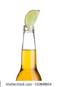 Mexican beer bottle with lime slice and frost on white background