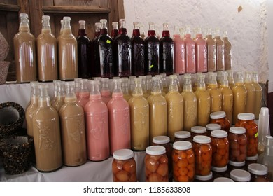 mexican beverages and fruits in bottles like rompope, mezcal and some fruits´desserts