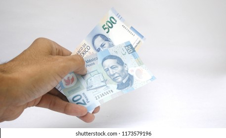 Mexican bills of 500 and 20 pesos, with white background
