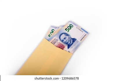 Mexican bills inside a yellow envelope