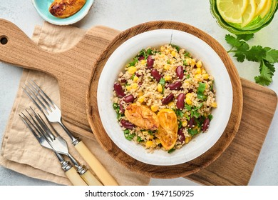 Mexican black bean corn quinoa salad with caramelized lemon in old vintage clay bowl on a light gray concrete background. Traditional Mexican cuisine dish. Top view, mock up.