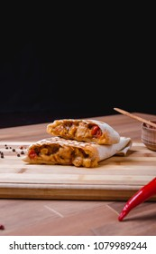 Mexican burrito with chicken , pepper and beans . Top view
