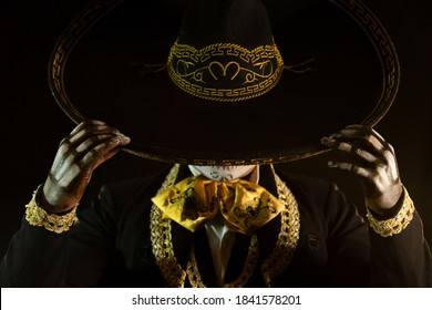 mexican charro holding his hat