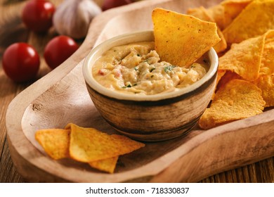 Mexican cheese dip served with nachos.