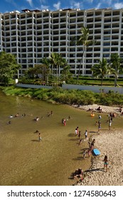 Mexican children playing in the Cuale river next to an exclusive highrise resort in Puerto Vallarta, Mexico - March 13, 2016