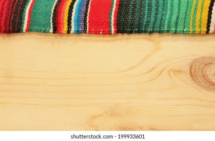 Mexican cinco de mayo fiesta serape poncho wood background with wooden copy space stock, photo, photograph, image, picture