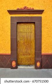Mexican colorful colonial style door in Bernal Queretaro Mexico.