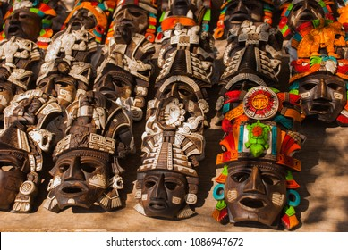 Mexican crafts for tourists on the market. Colorful Souvenirs, masks of Mayan warriors. Mexico