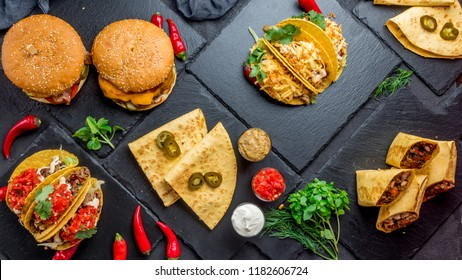 Mexican cuisine tacos, quesadillas, burrito, burgers top view