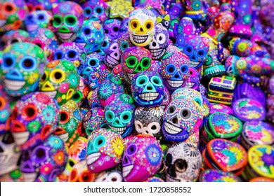 Mexican Culture Fiesta: Colorful (colourful) traditional Mexican/hispanic painted ceramic pottery Day of the Dead (Dia de los Muertos) skulls on display at a market in Mexico.