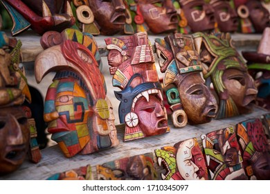 Mexican culture. Souvenirs from the trip. Masks on the shelf