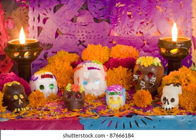 Mexican Day of the dead altar created entirely for this image session. Carefully arranged all the pieces, candles and flowers. Front View
