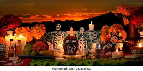 Mexican day of the dead altar at sunset at dim candlelight