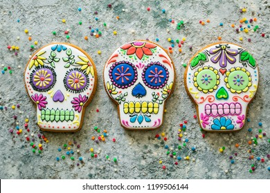 Mexican Day of the dead concept  skull shaped cookies with colorful decorations, top view