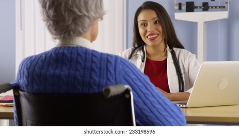 Mexican doctor sharing good news with patient